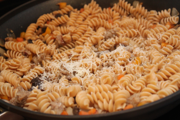 add sprinkled cheese to easy pasta and sausage